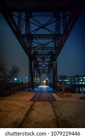 Vintage industrial railroad bridge crossing the Chicago river at night