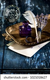 Vintage inkwell, feather quil penl and bunch lavender. Retro still life