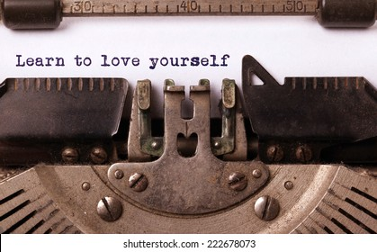 Vintage inscription made by old typewriter, Learn to love yourself