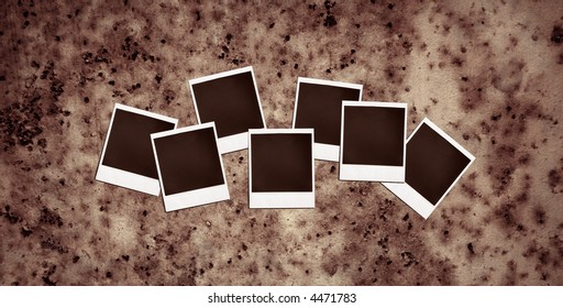 vintage instant photo frames on a rusty metal background