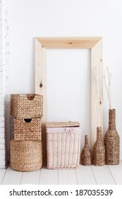 Vintage interior decor with wooden frame and wicker baskets