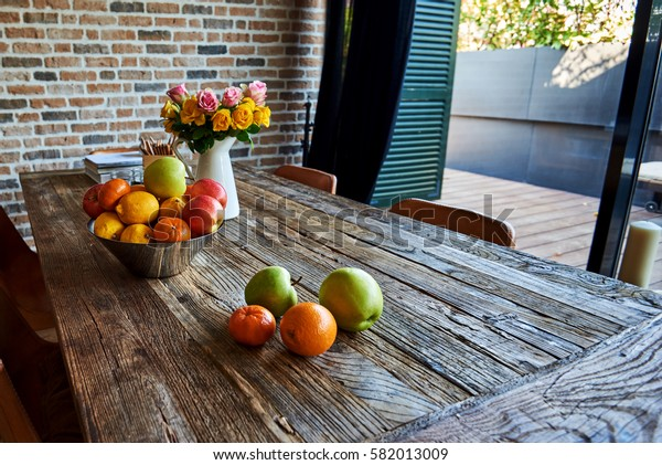 Vintage interior with table. Fruit and flowers on wooden retro table.