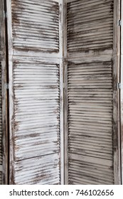 Vintage interior with white delicate decorative old wood panel