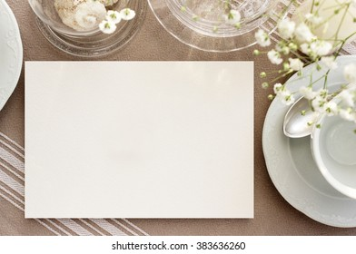 Vintage invitation, menu mockup. Blank card on a table with beautiful dishes for tea.