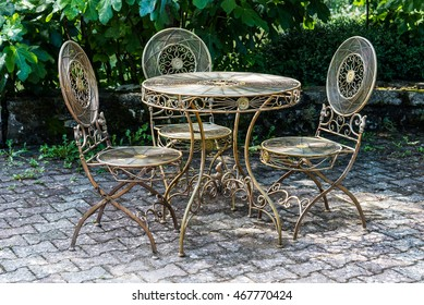 Vintage iron furniture for garden in a green relaxing corner