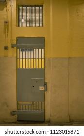 vintage iron jail door in prison building with copy space incinematic tone