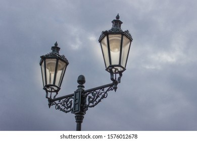 Vintage iron lantern on the wall outdoor. The street light in blue sky. Copy, empty space for text