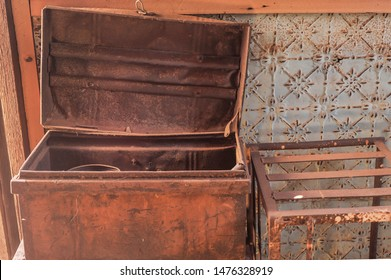 Vintage iron trunk used on wagons and trains to carry personal belongings.Old derelict iron trunk, rusted and wrecked, still used up to the 1950's goldfields Western Australia.
