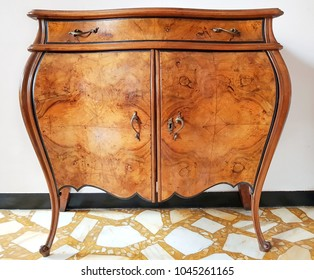 Vintage, italian brown wooden cupboard,  antique cupboard, clothes closet, vanity table, isolated on white background with clipping path.