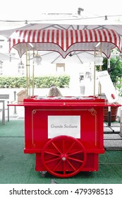 Vintage Italian Ice Cream Cart in Red. Old-fashioned ice cream truck. Granite siciliane (also called granita siciliana) means a semi-frozen dessert made from sugar, water and various flavorings