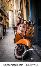 Vintage italian scooter in a alley of historic city center of Nice, France