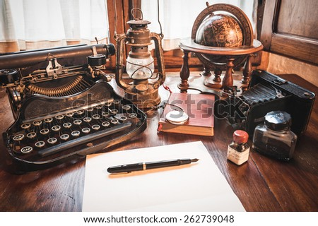 Vintage items, camera, pen, globe, clock, typewriter on the old desk - Vintage Items Camera Pen Globe Clock Stock Photo (Edit Now