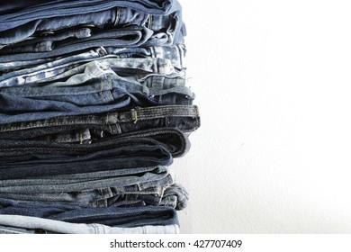 Vintage jeans,stack of jeans background,soft focus,soft color