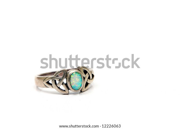 Vintage jewelery in silver and other semi-precious materials. Opal ring.