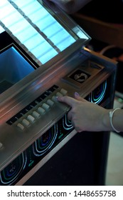 The vintage jukebox in the night cafe.