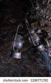 vintage kerosene lamp inside rocky tunnel