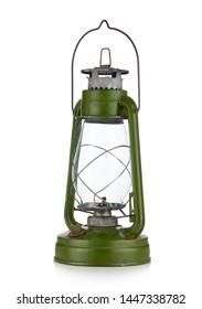 Vintage kerosene lamp isolated on white background. Glass oil lamp. Storm lantern. Diagonal view