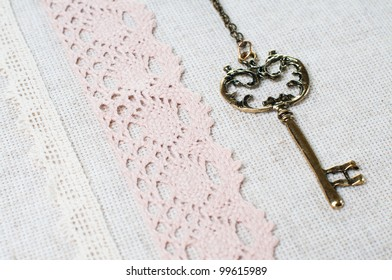 Vintage key, natural linen fabric and exquisite handmade lace