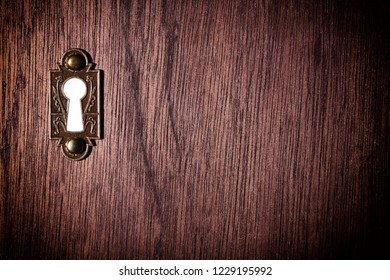 Vintage keyhole on a wooden door