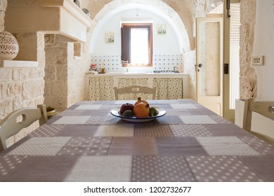 Vintage kitchen and dining table in a an old trullo of Puglia, Italy