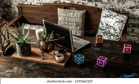 Vintage kitchen table with, laptop, coffee mug, pillows, plants and adobe cubes