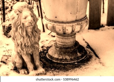 Vintage kitsch lion covered with snow beside a flower bucket with patina. Closeup of white planter in winter garden for book cover, brochure, flyer, magazine, design template, image with filter effect