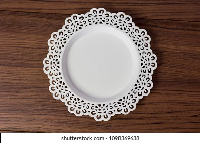 vintage lace plate white color for cake and dessert on wooden table. topview shot.