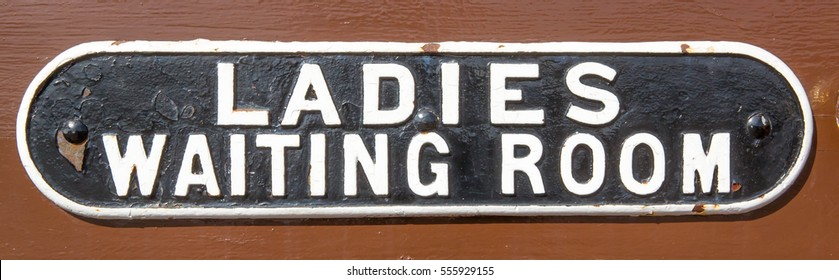 Vintage Ladies Waiting Room sign on a railway station door