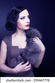 Vintage lady. Young woman in brown dress and in furs.