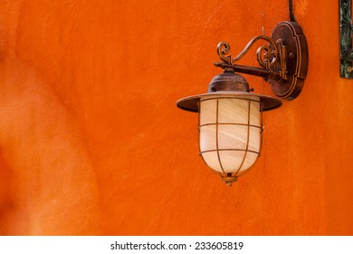 Vintage lamp on new yellow wall