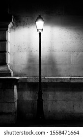 Vintage lamp post in Paris, black and white photography and light film grain
