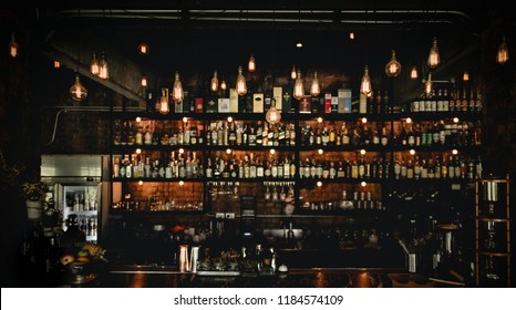vintage lamps with blurred liquor bar