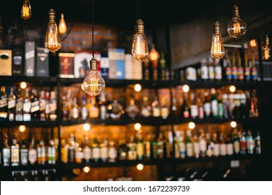 vintage lamps  with liquor bar background - Shutterstock ID 1672239739