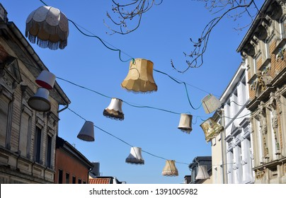 Vintage lampshades hanging from house to house in Mönchengladbach Germany