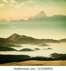 Vintage landscape with mountain peaks and mist, nature background, film filter