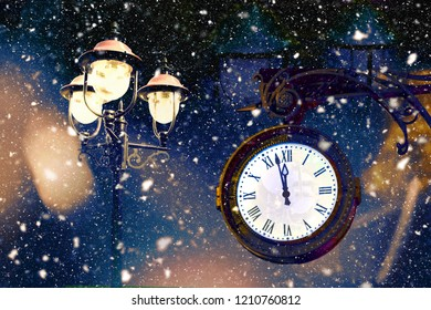 Vintage lantern and clock with snowflakes. Two minutes to twelve