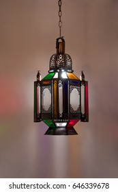 Vintage lantern in oriental style. Against the background of colored lights.