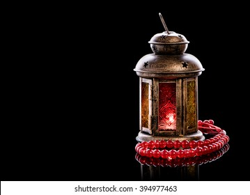 Vintage lantern with red rosary.