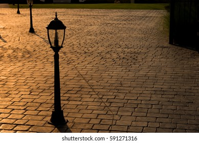 Vintage lanterns on stamp concrete floor.