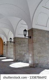 Vintage lanterns under a vaulted roof in the entrance to the Bavarian State Tax Office formerly the Nazi-era financial headquarters in Munich, Bavaria, Germany