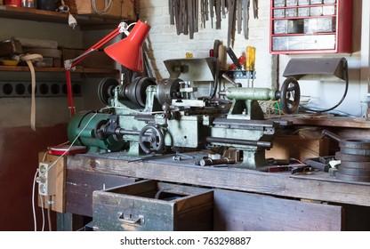 Vintage lathe machine in an old garage
