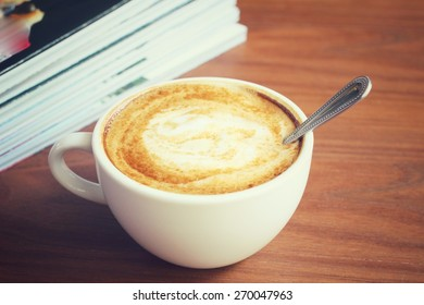 Vintage latte art coffee with books