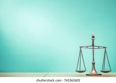 Vintage law scales front mint green background. Symbols of justice. Retro old style filtered photo