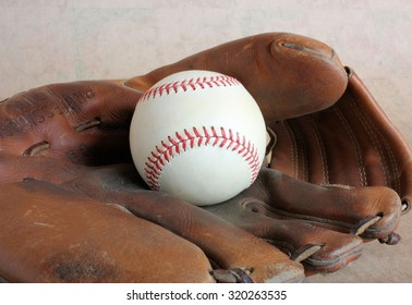 Vintage Leather Baseball Glove and Baseball with Red Stitching