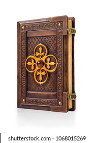Vintage leather bound book with large brass ornament and amber stone in the center of the book. Stand up with view from the right side.