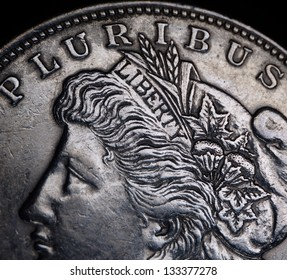 Vintage Liberty head on US Morgan silver dollar coin 1921. Macro with selective focus.