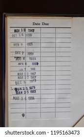 A vintage library book with due date stamps from November 1949 through March 1994.