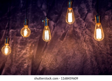Vintage light bulb glowing in the dark