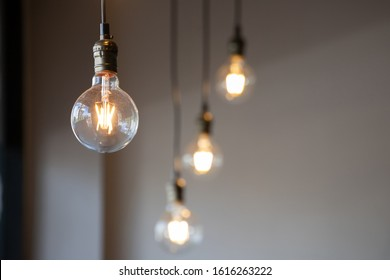 vintage light bulb hanging from ceiling for decoration in living room.
