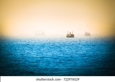 Vintage light falloff view to sea horizon with different ships in the distance (copy space)/Nostalgic Sea Voyage
